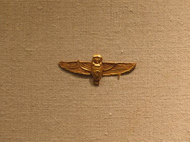 <em>Amulet Representing the Ba-bird</em>, ca. 664-30 B.C.E. Gold, 11/16 x 1 3/4 in. (1.7 x 4.5 cm). Brooklyn Museum, Charles Edwin Wilbour Fund, 08.480.213. Creative Commons-BY (Photo: Brooklyn Museum, CUR.08.480.213_wwg8.jpg)