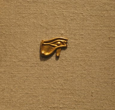 <em>Eye Amulet</em>, ca. 664-30 B.C.E. Sheet gold, 1/2 x 11/16 in. (1.3 x 1.8 cm). Brooklyn Museum, Charles Edwin Wilbour Fund, 08.480.217. Creative Commons-BY (Photo: Brooklyn Museum, CUR.08.480.217_wwg8.jpg)