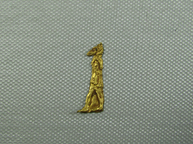 <em>Anubis Amulet</em>, 664-30 B.C.E. Gold, 1 1/8 x 7/16 x 1/16 in. (2.8 x 1.1 x 0.1 cm). Brooklyn Museum, Charles Edwin Wilbour Fund, 08.480.219. Creative Commons-BY (Photo: Brooklyn Museum, CUR.08.480.219.jpg)