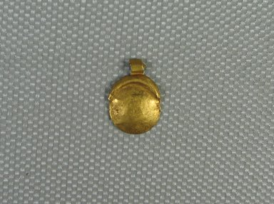 <em>Sun Disk and Crescent Amulet</em>, 664-30 B.C.E. Gold, 9/16 x 3/8 x 1/16 in. (1.4 x 1 x 0.1 cm). Brooklyn Museum, Charles Edwin Wilbour Fund, 08.480.220. Creative Commons-BY (Photo: Brooklyn Museum, CUR.08.480.220_view1.jpg)