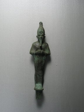 <em>Standing Mummiform Statuette of Osiris</em>, 664-332 B.C.E. Bronze, 8 3/16 x 2 1/2 x 1 3/16 in. (20.8 x 6.3 x 3 cm). Brooklyn Museum, Charles Edwin Wilbour Fund, 08.480.23. Creative Commons-BY (Photo: Brooklyn Museum, CUR.08.480.23_view1.jpg)