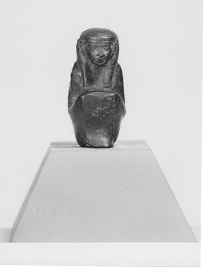 <em>Small Seated Figure of Maat</em>, 305-30 B.C.E. Bronze, 1 9/16 x 11/16 in. (3.9 x 1.8 cm). Brooklyn Museum, Charles Edwin Wilbour Fund, 08.480.34. Creative Commons-BY (Photo: Brooklyn Museum, CUR.08.480.34_negA_bw.jpg)