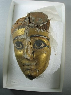 <em>Gilded Mummy Mask</em>, 101-200 C.E. Linen or papyrus mixed with plaster, pigment, gold leaf, 6 1/2 x 4 5/16 in. (16.5 x 11 cm). Brooklyn Museum, Charles Edwin Wilbour Fund, 08.480.3. Creative Commons-BY (Photo: Brooklyn Museum, CUR.08.480.3_view1.jpg)