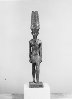 <em>Standing Statuette of Amon</em>, 332 B.C.E.-30 C.E. Bronze, 4 x 11/16 in. (10.2 x 1.8 cm). Brooklyn Museum, Charles Edwin Wilbour Fund, 08.480.43. Creative Commons-BY (Photo: Brooklyn Museum, CUR.08.480.43_negB_bw.jpg)
