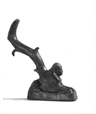 Graeco-Egyptian. <em>Reclining Sphinx</em>, 332-ca. 31 B.C.E. Bronze, 4 1/2 x 3/4 x 2 3/4 in. (11.5 x 1.9 x 7 cm). Brooklyn Museum, Charles Edwin Wilbour Fund, 08.480.51. Creative Commons-BY (Photo: Brooklyn Museum, CUR.08.480.51_NegA_print_bw.jpg)