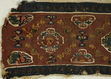 Coptic. <em>Fragments of Border with Botanical Decoration</em>, 7th-8th century C.E. Flax, wool, 8 x 14 3/16 in. (20.3 x 36 cm). Brooklyn Museum, Charles Edwin Wilbour Fund, 08.480.53. Creative Commons-BY (Photo: Brooklyn Museum (in collaboration with Index of Christian Art, Princeton University), CUR.08.480.53_detail01_ICA.jpg)