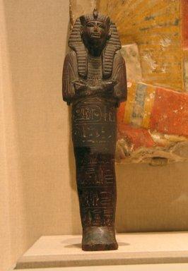 <em>Funerary Figurine of Ramesses II</em>, ca. 1292-1190 B.C.E. Wood, 12 1/2 x 3 7/16 in. (31.8 x 8.7 cm). Brooklyn Museum, Charles Edwin Wilbour Fund, 08.480.5. Creative Commons-BY (Photo: Brooklyn Museum, CUR.08.480.5_wwg8.jpg)