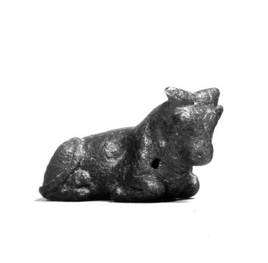 <em>Figure of a Recumbent Bull</em>, 332-31 B.C.E. Bronze, 11/16 x 1 1/16 x 2 1/16 in. (1.7 x 2.7 x 5.2 cm). Brooklyn Museum, Charles Edwin Wilbour Fund, 08.480.63. Creative Commons-BY (Photo: Brooklyn Museum, CUR.08.480.63_NegA_print_bw.jpg)