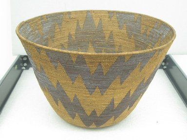 Amanda Wilson (Maidu, ca. 1860-1946). <em>Cooking or Mush Basket</em>, 1860-1909. Maple sucker shoots, redbud bark, willow shoots (possibly)., 10 1/2 x 16 1/4 in. (26.7 x 41.3 cm). Brooklyn Museum, Museum Expedition 1908, Museum Collection Fund, 08.491.8677. Creative Commons-BY (Photo: Brooklyn Museum, CUR.08.491.8677_view1.jpg)