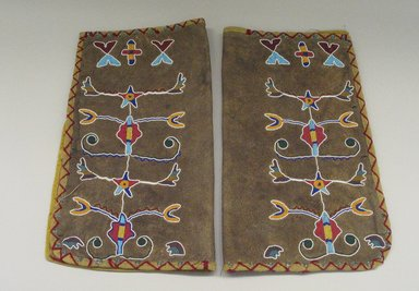 Nez Perce. <em>Pair of Leggings beaded with floral and foliate designs</em>, late 19th-early 20th century. Beads, leather, wool, meta, cotton cloth, 19 5/16 x 23 7/16 in.  (49.0 x 59.5 cm). Brooklyn Museum, Brooklyn Museum Collection, 09.798a-b. Creative Commons-BY (Photo: Brooklyn Museum, CUR.09.798a-b_view1.jpg)