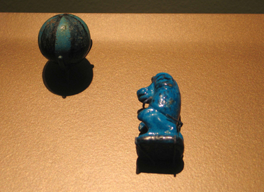 <em>Game Piece in Form of an Ape</em>, ca. 1539-1390 B.C.E. Faience, 1 7/8 x 1 1/8 in. (4.7 x 2.8 cm). Brooklyn Museum, Charles Edwin Wilbour Fund, 36.125. Creative Commons-BY (Photo: , CUR.09.879_36.125_erg456.jpg)