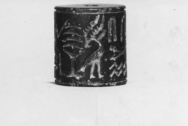 <em>Cylinder Seal</em>, ca. 3100-2675 B.C.E. Steatite, 1 x 15/16 in. (2.6 x 2.4 cm). Brooklyn Museum, Charles Edwin Wilbour Fund, 09.889.115. Creative Commons-BY (Photo: Brooklyn Museum, CUR.09.889.115_NegA_print_bw.jpg)