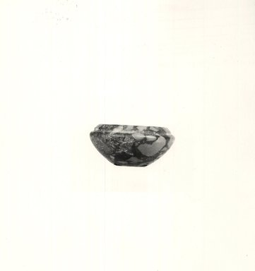 <em>Small Cup</em>, ca. 3100-2675 B.C.E. Breccia, 1 1/8 x Greatest Diam. 2 5/16 in. (2.9 x 5.9 cm). Brooklyn Museum, Charles Edwin Wilbour Fund, 09.889.15. Creative Commons-BY (Photo: Brooklyn Museum, CUR.09.889.15_NegA_print_bw.jpg)