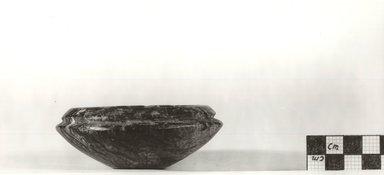 <em>Small Flat Cup</em>, ca. 3100-2625 B.C.E. Marble (possibly), 1 3/8 x Greatest Diam. 3 5/8 in. (3.5 x 9.2 cm). Brooklyn Museum, Charles Edwin Wilbour Fund, 09.889.17. Creative Commons-BY (Photo: Brooklyn Museum, CUR.09.889.17_NegA_print_bw.jpg)