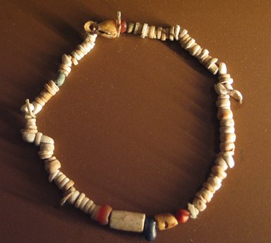 <em>Beaded Necklace</em>, ca. 3300-3100 B.C.E. Shell, faience, carnelian, limestone, lapis lazuli, Largest bead: 5/8 x 3/8 in. (1.6 x 0.9 cm). Brooklyn Museum, Charles Edwin Wilbour Fund, 09.889.304. Creative Commons-BY (Photo: Brooklyn Museum, CUR.09.889.304_erg3.jpg)