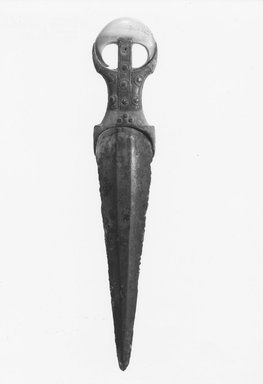 <em>Dagger</em>, ca. 1539-1292 B.C.E. Copper alloy, wood, metal, ivory, and leather, 2 1/4 × 5/8 × 11 3/8 in. (5.7 × 1.6 × 28.9 cm). Brooklyn Museum, Charles Edwin Wilbour Fund, 09.889.339. Creative Commons-BY (Photo: Brooklyn Museum, CUR.09.889.339_NegA_print_bw.jpg)