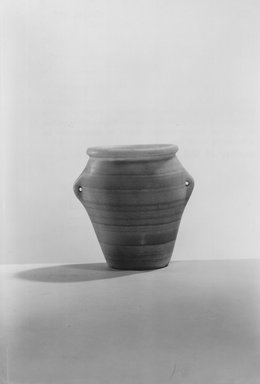 <em>Standing Vase with Handles</em>, ca. 3300-3100 B.C.E. Egyptian alabaster (calcite), 3 7/16 x Diam. 3 9/16 in. (8.8 x 9 cm). Brooklyn Museum, Charles Edwin Wilbour Fund, 09.889.35. Creative Commons-BY (Photo: Brooklyn Museum, CUR.09.889.35_NegA_print_bw.jpg)