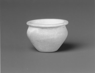 <em>Pear-Shaped Kohl Pot</em>, ca. 1938-1630 B.C.E. Egyptian alabaster (calcite), 7/8 in. (2.3 cm) high x 1 3/16 in. (3 cm) diameter. Brooklyn Museum, Charles Edwin Wilbour Fund, 09.889.39. Creative Commons-BY (Photo: Brooklyn Museum, CUR.09.889.39_NegA_print_bw.jpg)