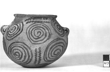 <em>Broad Flat Urn with Two Handles</em>, ca. 3500-3300 B.C.E. Terracotta, pigment, 3 7/16 x Diam. 4 9/16 in. (8.8 x 11.6 cm). Brooklyn Museum, Charles Edwin Wilbour Fund, 09.889.408. Creative Commons-BY (Photo: Brooklyn Museum, CUR.09.889.408_NegB_print_bw.jpg)