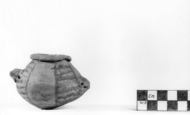 <em>Urn Shape with Two Handles</em>, ca. 4100-3300 B.C.E. Terracotta, pigment, 2 x 2 15/16 in. (5.1 x 7.5 cm). Brooklyn Museum, Charles Edwin Wilbour Fund, 09.889.411. Creative Commons-BY (Photo: Brooklyn Museum, CUR.09.889.411_NegA_print_bw.jpg)