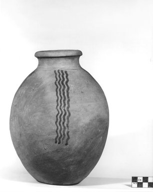 <em>Urn Decorated with Dark Brown Wavy Lines</em>. Terracotta, 9 7/16 x 6 7/8 in. (24 x 17.5 cm). Brooklyn Museum, Charles Edwin Wilbour Fund, 09.889.427. Creative Commons-BY (Photo: Brooklyn Museum, CUR.09.889.427_NegA_print_bw.jpg)
