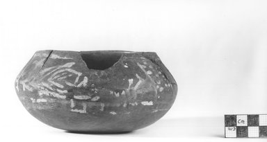 <em>Flat Urn</em>, ca. 4400-3100 B.C.E. Clay, pigment, 2 11/16 x 5 11/16 in. (6.8 x 14.4 cm). Brooklyn Museum, Charles Edwin Wilbour Fund, 09.889.443. Creative Commons-BY (Photo: Brooklyn Museum, CUR.09.889.443_NegA_print_bw.jpg)