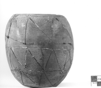<em>Jar with Impressed and Incised Decoration</em>, ca. 3300-3100 B.C.E. Clay, paste, 5 1/16 x diam. of mouth 3 in. (12.8 x 7.6 cm). Brooklyn Museum, Charles Edwin Wilbour Fund, 09.889.445. Creative Commons-BY (Photo: Brooklyn Museum, CUR.09.889.445_NegA_print_bw.jpg)