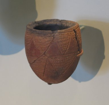 <em>Jar with Impressed and Incised Decoration</em>, ca. 3300-3100 B.C.E. Clay, pigment, 3 3/8 x greatest diam. 1 15/16 in. (8.5 x 5 cm). Brooklyn Museum, Charles Edwin Wilbour Fund, 09.889.446. Creative Commons-BY (Photo: Brooklyn Museum, CUR.09.889.446_erg456.jpg)
