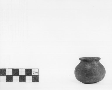 <em>Small Black Vase</em>, ca. 4400-3100 B.C.E. Clay, pigment, 1 7/16 x 1 3/4 in. (3.7 x 4.4 cm). Brooklyn Museum, Charles Edwin Wilbour Fund, 09.889.455. Creative Commons-BY (Photo: Brooklyn Museum, CUR.09.889.455_NegA_print_bw.jpg)