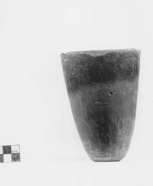 <em>Conical Goblet</em>. Clay, 5 5/16 x diam. of mouth 3 7/16 in. (13.5 x 8.8 cm). Brooklyn Museum, Charles Edwin Wilbour Fund, 09.889.463. Creative Commons-BY (Photo: Brooklyn Museum, CUR.09.889.463_NegA_print_bw.jpg)
