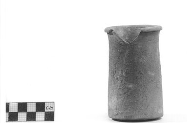 <em>Small Cylindrical Vase</em>, ca. 4400-3100 B.C.E. Terracotta, 3 3/4 x 2 3/16 in. (9.5 x 5.5 cm). Brooklyn Museum, Charles Edwin Wilbour Fund, 09.889.478. Creative Commons-BY (Photo: Brooklyn Museum, CUR.09.889.478_NegA_print_bw.jpg)