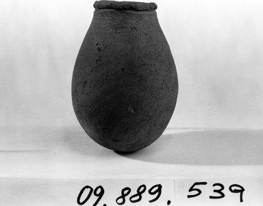 <em>Urn</em>. Terracotta, Height: 3 1/2in. (8.9cm), or 3 3/8 in. (8.6 cm). Brooklyn Museum, Charles Edwin Wilbour Fund, 09.889.539. Creative Commons-BY (Photo: Brooklyn Museum, CUR.09.889.539_NegB_print_bw.jpg)