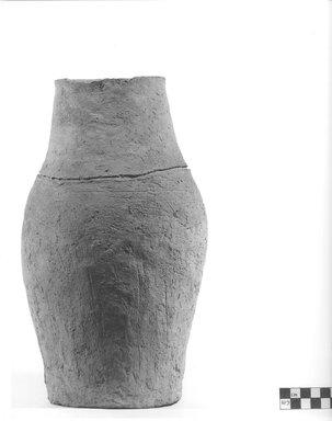 <em>Ovoid Shaped Storage Pot</em>, 30 B.C.E.-395 C.E. Terracotta, 12 9/16 x 2 3/4 in. (31.9 x 7 cm). Brooklyn Museum, Charles Edwin Wilbour Fund, 09.889.644. Creative Commons-BY (Photo: Brooklyn Museum, CUR.09.889.644_NegA_print_bw.jpg)