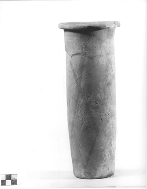 <em>Cylindrical Vase</em>, ca. 4400-3100 B.C.E. Terracotta, Height: 11 1/16 in. (28.1 cm). Brooklyn Museum, Charles Edwin Wilbour Fund, 09.889.663. Creative Commons-BY (Photo: Brooklyn Museum, CUR.09.889.663_NegA_print_bw.jpg)