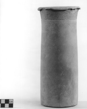 <em>Cylindrical Vase</em>. Terracotta, 9 1/2 x Diam. 3 5/16 in. (24.2 x 8.4 cm). Brooklyn Museum, Charles Edwin Wilbour Fund, 09.889.670. Creative Commons-BY (Photo: Brooklyn Museum, CUR.09.889.670_NegA_print_bw.jpg)
