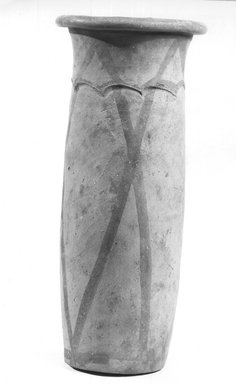 <em>Cylindrical Vase</em>, ca. 4400-3100 B.C.E. Terracotta, pigment, 9 7/16 x 4 1/8 in. (24 x 10.5 cm). Brooklyn Museum, Charles Edwin Wilbour Fund, 09.889.684. Creative Commons-BY (Photo: Brooklyn Museum, CUR.09.889.684_NegA_print_bw.jpg)