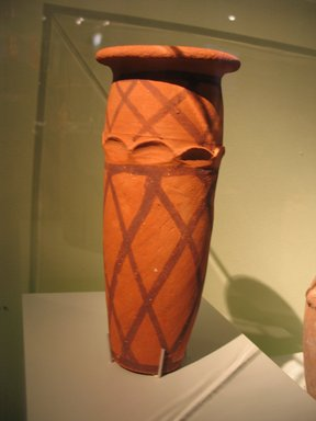 <em>Cylindrical Vase with Basket Decoration</em>, ca. 3500-3300 B.C.E. Terracotta, pigment, 9 5/8 x Diam. 4 1/4 in. (24.5 x 10.8 cm). Brooklyn Museum, Charles Edwin Wilbour Fund, 09.889.687. Creative Commons-BY (Photo: Brooklyn Museum, CUR.09.889.687_erg456.jpg)