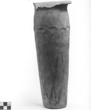 <em>Cylindrical Vase</em>. Terracotta, pigment, Height: 11 in. (28 cm). Brooklyn Museum, Charles Edwin Wilbour Fund, 09.889.689. Creative Commons-BY (Photo: Brooklyn Museum, CUR.09.889.689_NegA_print_bw.jpg)