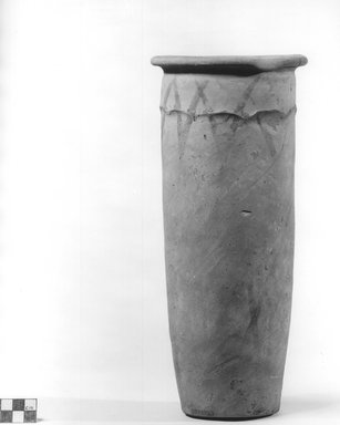 <em>Painted Cylindrical Vase with Wavy Handled Motif</em>, ca. 4400-3100 B.C.E. Terracotta, pigment, 11 13/16 x 5 1/8 in. (30 x 13 cm). Brooklyn Museum, Charles Edwin Wilbour Fund, 09.889.691. Creative Commons-BY (Photo: Brooklyn Museum, CUR.09.889.691_NegA_print_bw.jpg)