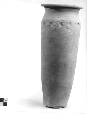 <em>Cylindrical Vase</em>. Clay, slip, Height: 10 1/4 in. (26.1 cm). Brooklyn Museum, Charles Edwin Wilbour Fund, 09.889.701. Creative Commons-BY (Photo: Brooklyn Museum, CUR.09.889.701_NegA_print_bw.jpg)