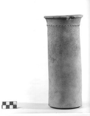 <em>Cylindrical Vase</em>, ca. 4400-3100 B.C.E. Terracotta, 9 15/16 x 3 11/16 in. (25.3 x 9.4 cm). Brooklyn Museum, Charles Edwin Wilbour Fund, 09.889.703. Creative Commons-BY (Photo: Brooklyn Museum, CUR.09.889.703_NegA_print_bw.jpg)