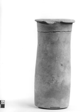 <em>Wavy Handled Cylindrical Vase</em>, ca. 4400-3100 B.C.E. Terracotta, 9 3/16 x 4 1/2 in. (23.3 x 11.5 cm). Brooklyn Museum, Charles Edwin Wilbour Fund, 09.889.705. Creative Commons-BY (Photo: Brooklyn Museum, CUR.09.889.705_NegA_print_bw.jpg)