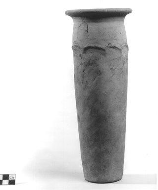 <em>Wavy Handled Cylindrical Vase</em>, ca. 4400-3100 B.C.E. Terracotta, pigment, 10 3/8 x 4 5/16 in. (26.3 x 11 cm). Brooklyn Museum, Charles Edwin Wilbour Fund, 09.889.708. Creative Commons-BY (Photo: Brooklyn Museum, CUR.09.889.708_NegA_print_bw.jpg)
