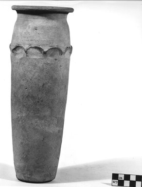 <em>Cylindrical Vase</em>. Clay, slip, Height: 11 5/8 in. (29.6 cm). Brooklyn Museum, Charles Edwin Wilbour Fund, 09.889.709. Creative Commons-BY (Photo: Brooklyn Museum, CUR.09.889.709_NegA_print_bw.jpg)