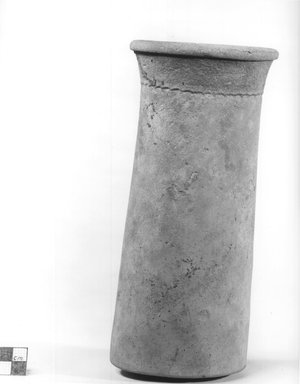 <em>Unglazed Cylindrical Vase</em>, ca. 4400-3100 B.C.E. Clay, slip, 8 7/8 x 4 in. (22.5 x 10.2 cm). Brooklyn Museum, Charles Edwin Wilbour Fund, 09.889.712. Creative Commons-BY (Photo: Brooklyn Museum, CUR.09.889.712_NegA_print_bw.jpg)