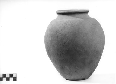 <em>Inverted Pear Shaped Jar</em>. Terracotta, Height: 7 5/8 in. (19.3 cm). Brooklyn Museum, Charles Edwin Wilbour Fund, 09.889.784. Creative Commons-BY (Photo: Brooklyn Museum, CUR.09.889.784_NegA_print_bw.jpg)