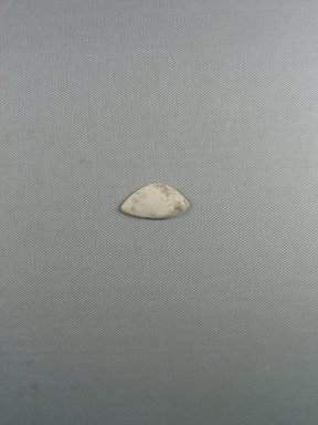 <em>Right Eye Inlay</em>. Limestone, 3/4 x 1 3/8 x 3/16 in. (1.9 x 3.5 x 0.5 cm). Brooklyn Museum, Charles Edwin Wilbour Fund, 09.889.856 (Photo: Brooklyn Museum, CUR.09.889.856_view1.jpg)
