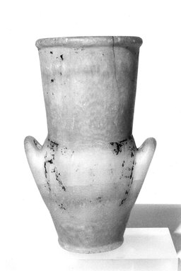 <em>Amphora with Painted Floral Collar</em>, ca. 1292-1075 B.C.E. Egyptian alabaster, traces of paint, 7 9/16 x 4 3/4 x diam. 3 11/16 in. (19.2 x 12 x 9.4 cm). Brooklyn Museum, Charles Edwin Wilbour Fund, 09.889.92. Creative Commons-BY (Photo: Brooklyn Museum, CUR.09.889.92_NegL1011_3_print_bw.jpg)