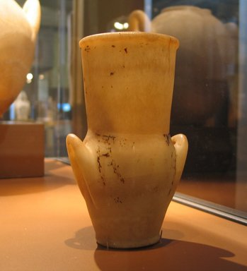 <em>Amphora with Painted Floral Collar</em>, ca. 1292-1075 B.C.E. Egyptian alabaster, traces of paint, 7 9/16 x 4 3/4 x diam. 3 11/16 in. (19.2 x 12 x 9.4 cm). Brooklyn Museum, Charles Edwin Wilbour Fund, 09.889.92. Creative Commons-BY (Photo: Brooklyn Museum, CUR.09.889.92_erg456.jpg)