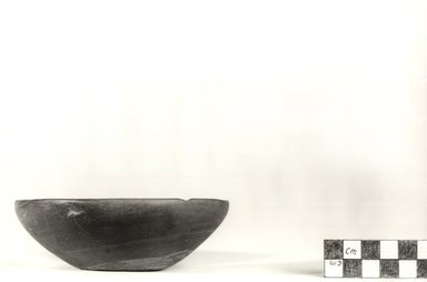 <em>Flat Cup</em>, ca. 4400-3100 B.C.E. Slate, 1 1/2 x Diam. 4 1/2 in. (3.8 x 11.4 cm). Brooklyn Museum, Charles Edwin Wilbour Fund, 09.889.9. Creative Commons-BY (Photo: Brooklyn Museum, CUR.09.889.9_NegA_print_bw.jpg)